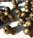 Metalinis bronzinis varpelis 10 mm, su kilpele